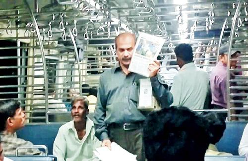 Academic-turned-social worker Sandeep Desai, in a local train to raise funds for setting up schools for underprivileged children