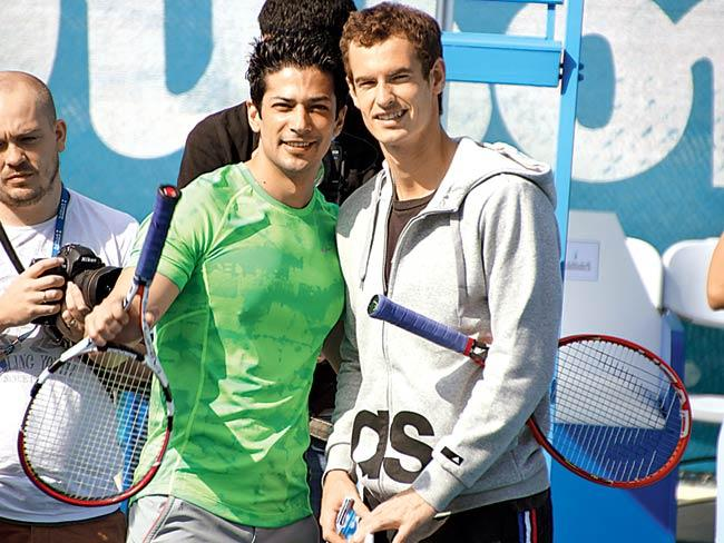 Muzammil Ibrahim (left) with Andy Murray