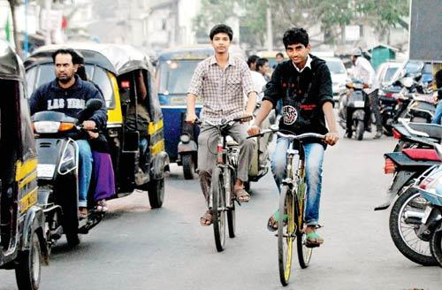 Conditions Apply: The bicycles will be provided to those students of Std VII-X, whose homes are more than  2 kilometres away from their respective PMC schools. Representation Pic
