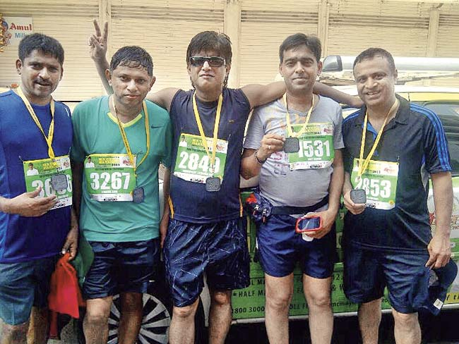 Amit Kasat (fourth from left) is still recuperating in hospital after he collapsed a kilometre away from the finish line during the half-marathon