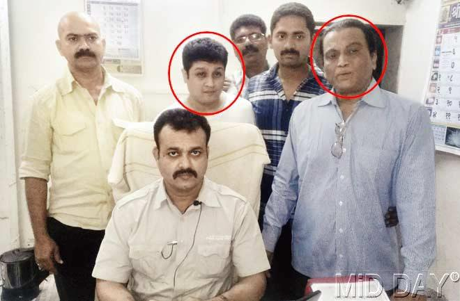 Chandrakant Mukherjee (circled, right) and his son Samarth (circled, left) at the Oshiwara police station