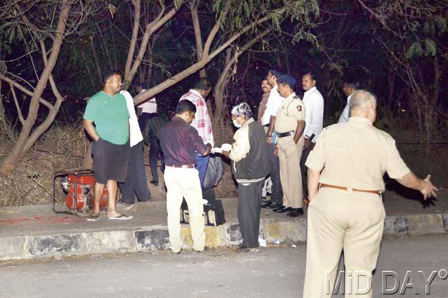 Police officers investigate at the site where Esther Anuhya's charred body was found in the bushes of Bhandup. Pic/Datta Kumbhar