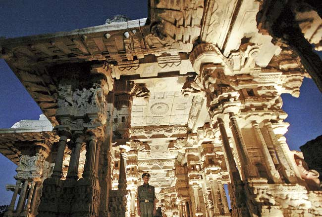 Temples in Hampi boast of rich architectural heritage with intricate carvings. PIC/AFP
