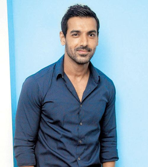 John Abraham holds the date