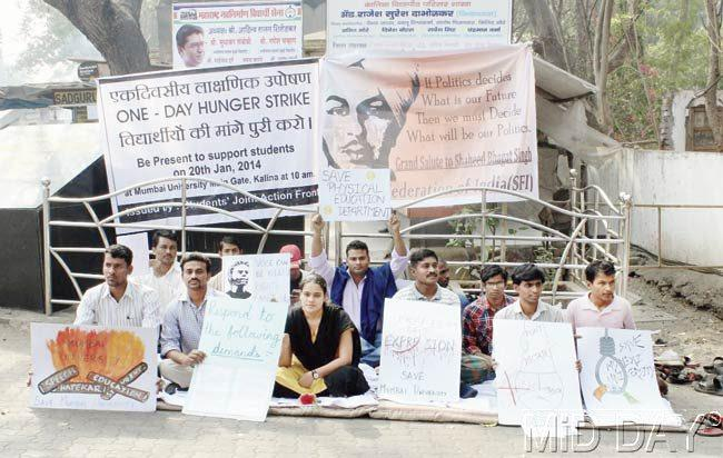 Members of SAVE MU group protesting outside the main entrance of Kalina campus yesterday