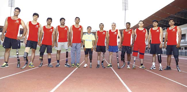 Kiran Kanojia (centre), the only female blade runner, with other participants