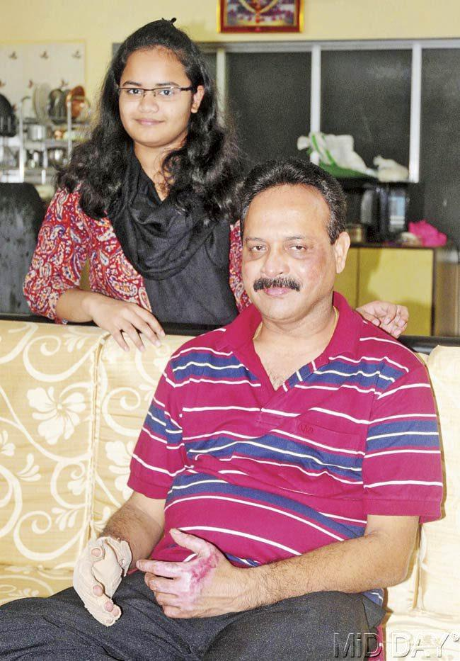 Mahendra Desai, fire officer at Gowalia Tank station, with his daughter Shivani at his Tardeo flat. Pic/Bipin Kokate
