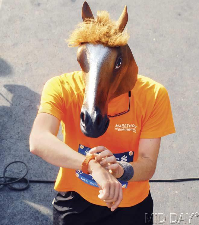 A participant with a horse head piece runs in the marathon. Pic/Atul Kamble