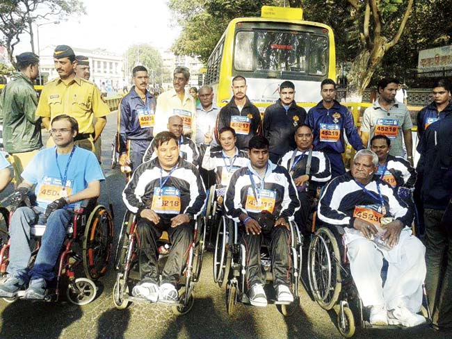 Nirvasdur Bahdur Burumg (second from left, in wheelchair), along with seven other members of the Paraplegic Rehab Centre in Pune, completed the Champions With Disability race