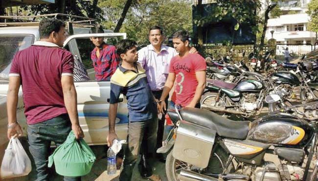 When cops arrested Dutt Raj Bholar (in blue T-shirt), Prashant Pawar (in red) and Siddharth Chaurasia (in check shirt), they also found a sickle, chilli powder and women's make-up