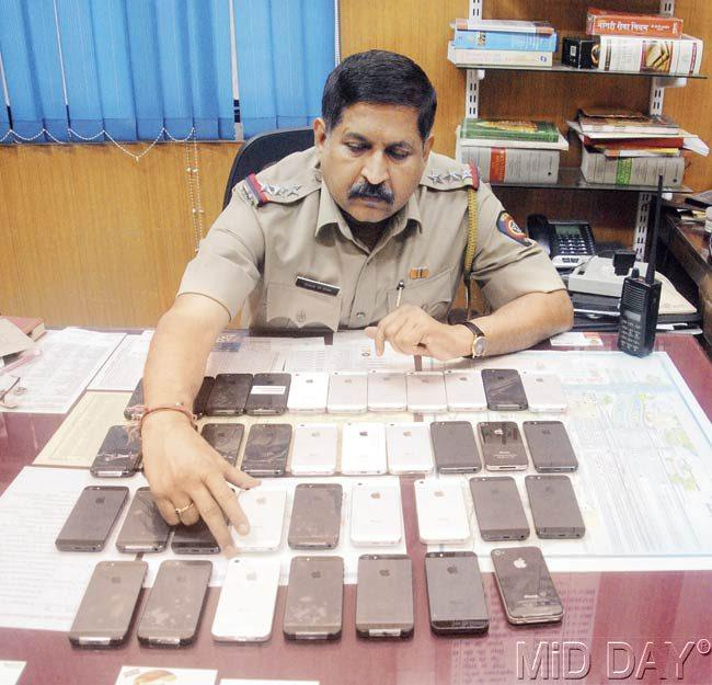 Railway police recovered 36 stolen iPhones from the two men, one of whom is a Rajdhani train attendant. Pic/ Milind Karekar