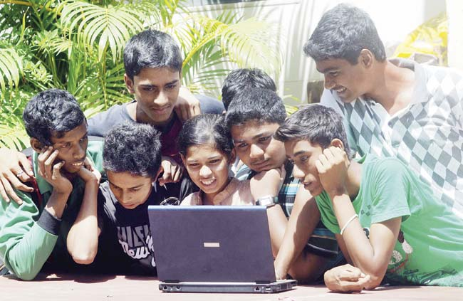 SSC pass children of domestic and construction workers will be provided laptops, while those studying in Std V to X will be given tablets to enhance learning skills. Representation Pic