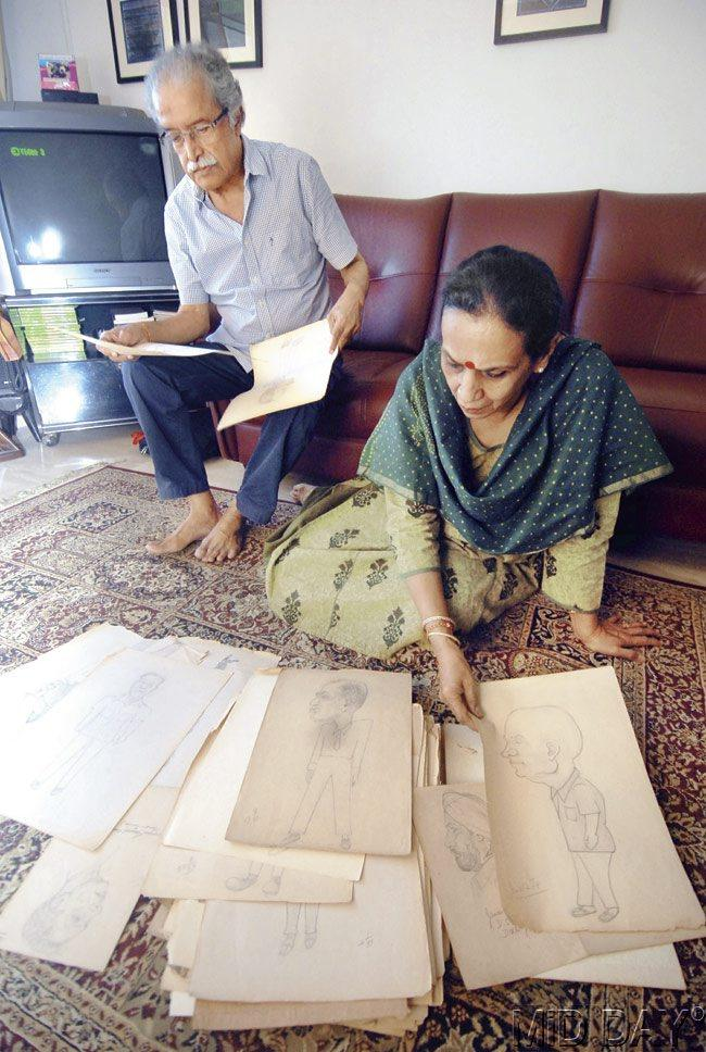 Shakuntala and Raja, daughter and son-in-law of late police inspector Balchandra Haldipur, go through sketches made by the cop, including one of Godse. Pic/Sameer Markande