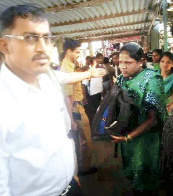 Wadala GRP officials at Kurla. A woman constable (in green) holds the bag in which the baby was found