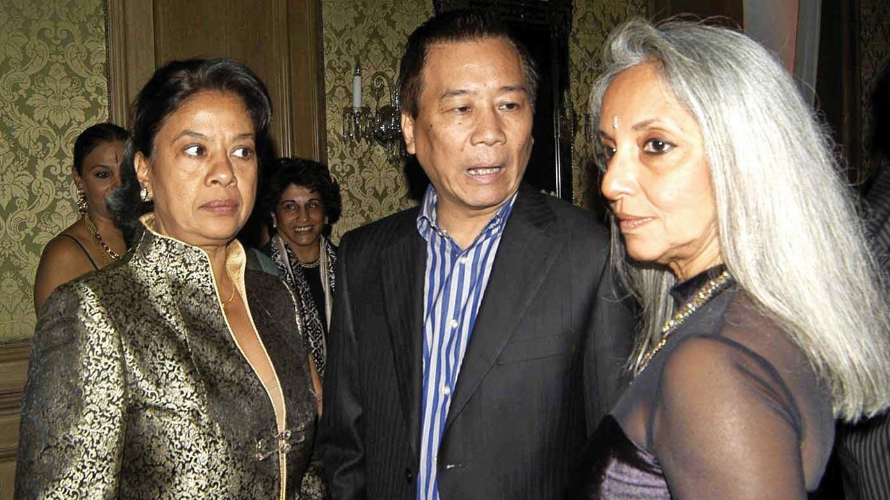 Henry Tham (centre) with his wife (left) and Monica Vazirali at a party